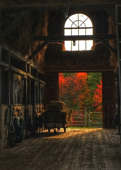 srping creek barn with fall foliage around