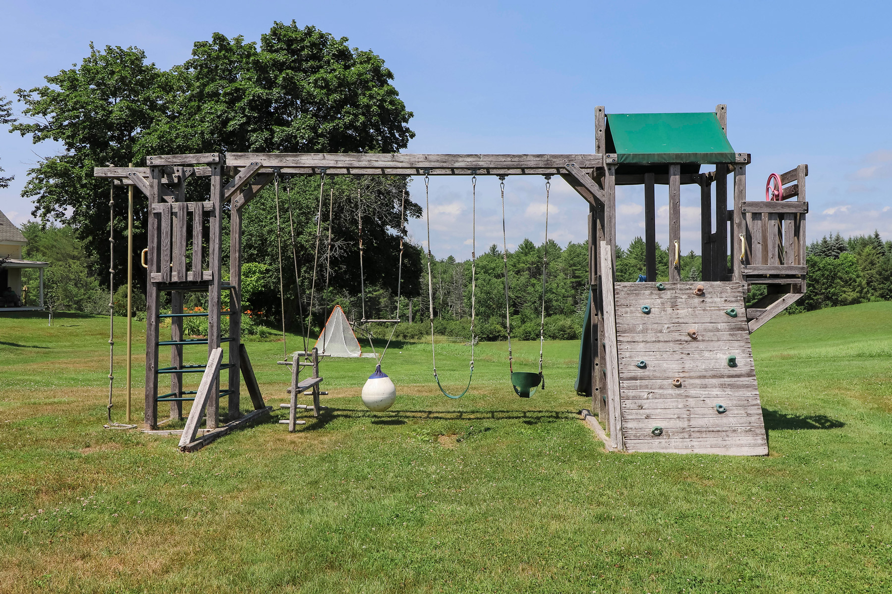 kids swings and climbing structure